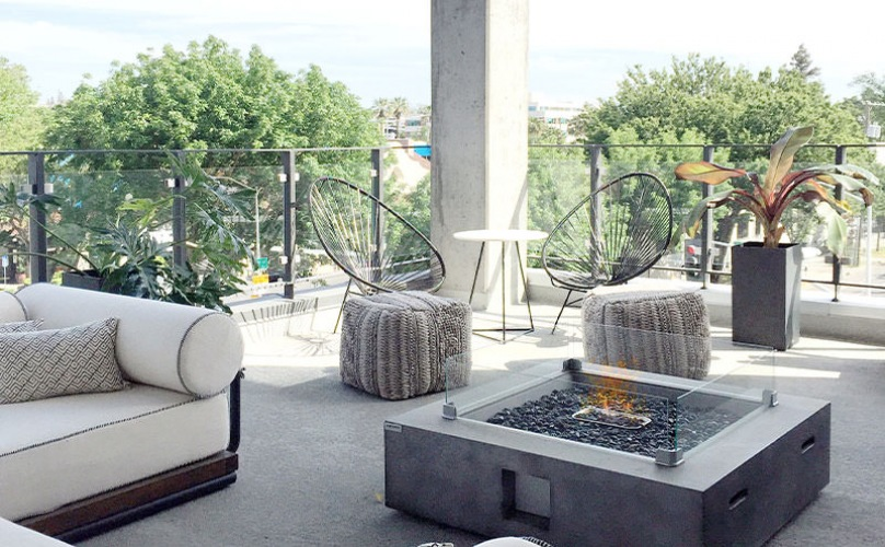 Rooftop deck with city views and plenty of lounge seating